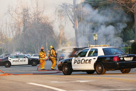 fire fighter: Temple City, California, USA - February 12, 2016: Fire fighter Extinguishing a burning car, California