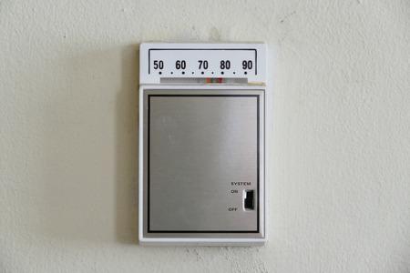 control box: Retro room temperature control box of thermostat Stock Photo