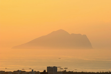 sun rise: Sun rise and Guishan Island with building below, Taiwan Stock Photo