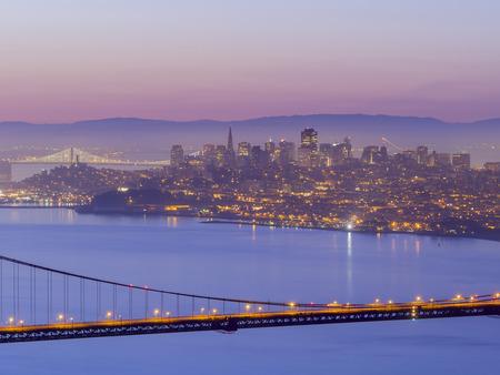 sun rise: The famous Golden Gate Bridge with Sanfrancisco skyline around sun rise time, SFO, California
