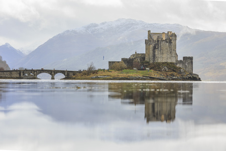 historical reflections: The famous Eilean Donan Castle at Highland, Scotland Editorial
