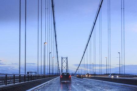 forth: Driving through the Forth Road Bridge in a rainy day Stock Photo