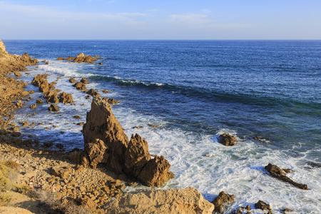Beautiful sea shore, rocks at Beach around afternoon Stock Photo