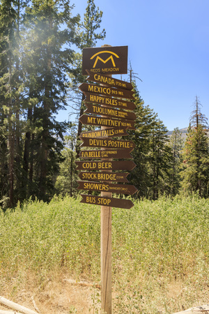 end of the trail: Wooden sign of the trail end at Reds Meadow Resort & Pack Station Stock Photo