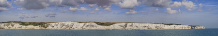dover: The White Cliffs of Dover with blue sky and clouds