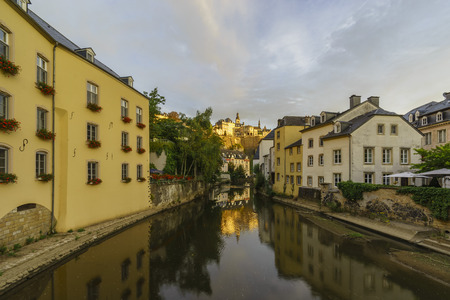river side: Beautiful Alzette river side scene on road Rue Munster of Luxembourg at sun rise