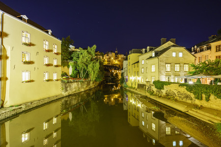 river side: Alzette river side scene on road Rue Munster of Luxembourg at night