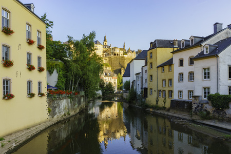 sun rise: Alzette river side scene on road Rue Munster of Luxembourg at sun rise