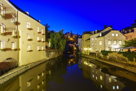 Beautiful Alzette river side scene on road Rue Munster of Luxembourg at night