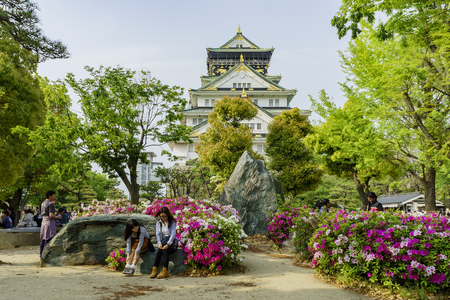 castle rock: Osaka, APR 30: The famous and historical Osaka Castle with Rhododendron on APR 30, 2011 at Osaka, Japan Editorial