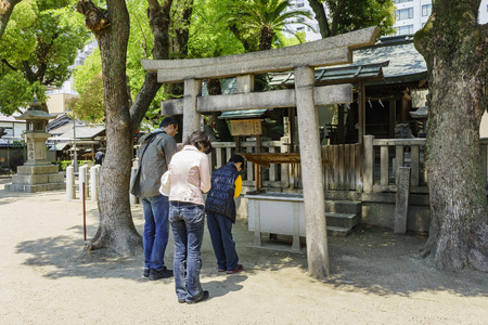 worshipping: Osaka, APR 29: Family worshipping at old historical temple on APR 29, 2011 at Osaka city, Japan Editorial