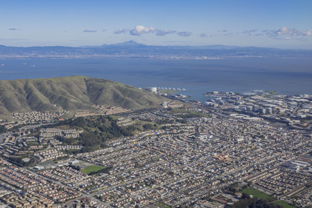 Aerial view of South San Francisco cityscape with blue sky, California