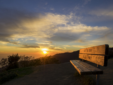 overlook: Sunset with beautiful clouds and chair of Parker Mesa Overlook