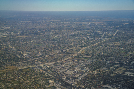 Aerial view of Santa Fe Springs, Norwalkm Bellflower, Downey, view from window seat in an airplane, California, U.S.A. Stock Photo