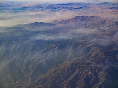 Aerial view of San Bernardino Mountains and Lake Arrowhead, view from window seat in an airplane, California, U.S.A. Stock Photo