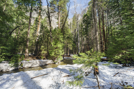 Merced river with snow and mountains at Yosemite National Park, California, USA Stock Photo