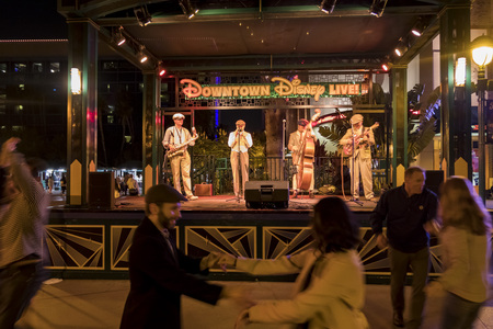 Anaheim, NOV 11: People dancing in the famous Downtown Disney District, Disneyland Resort on NOV 11, 2017 at Anaheim, Orange County, California, United States
