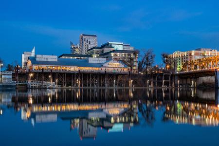 Sacramento, FEB 22: Night view of Sacramento skyline with Sacramento River on FEB 22, 2018 at Sacramento, California