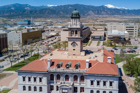 Aerial view of the Colorado Springs Pioneers Museum with mountain background