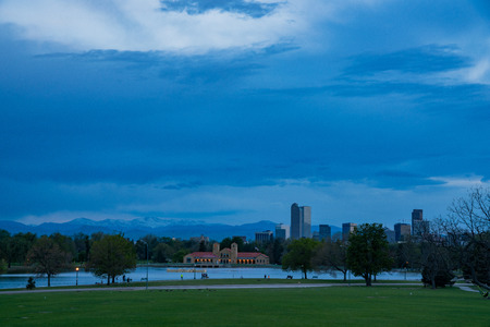 Afternoon cloudy view of the downtown skyline from city park at Denver, Colorado