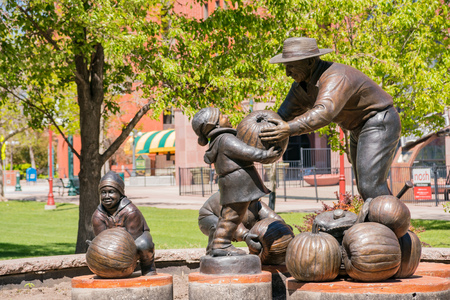 Colorado Springs, MAY 4: Pumpingkin harvest statue in the Pioneers Museum on MAY 4, 2017 at Colorado Springs, Colorado