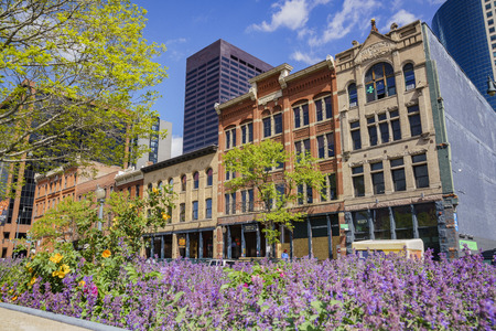 Denver, MAY 3: Beautiful building and purple flower blossom in downtown on MAY 3, 2017 at Denver, Colorado