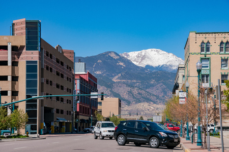 Colorado Springs, MAY 4: Street view with snow mountain on MAY 4, 2017 at Colorado Springs, Colorado Editorial