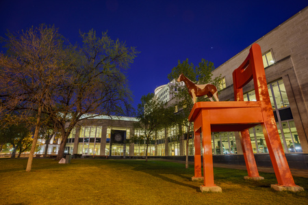 Night view of the Big red chair and horse statue of the Denver Central Library in the Civic center Editorial
