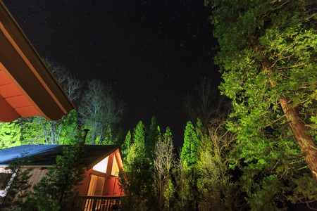 Night view of the wooden house in Bass Lake at Madera County, California