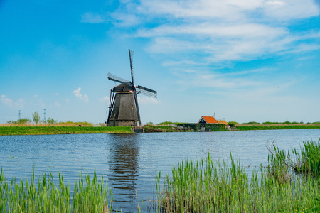 Afternoon view of the famous Kinderdijk winmill village at Netherlands Фото со стока