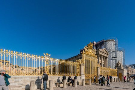 Versailles, MAY 4: The golden entrance gate of the famous Palace of Versailles on MAY 4 at Versailles, France Stock Photo - 116109758
