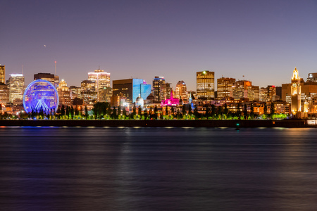 Night view of the Montreal city skyline, city hall with St Lawrence river at Quebec, Canada Редакционное