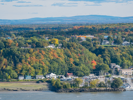 Afternoon sunny view of Levis city with fall color at Quebec, Canada Фото со стока