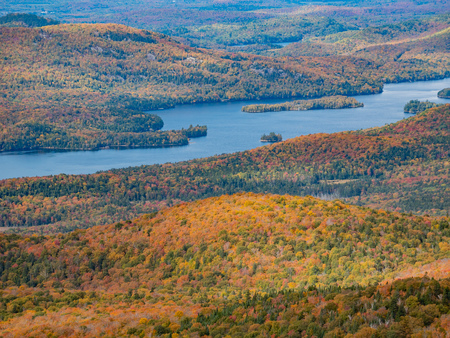 Aerial view of Mont-Tremblant National Park with Lake Tremblant in fall color at Quebec, Canada Banco de Imagens