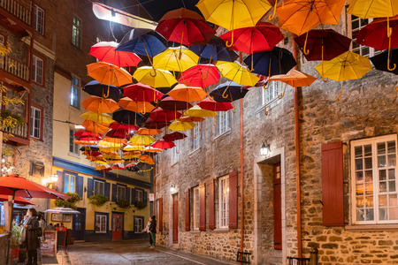 Quebec, OCT 3: Night view of the Breakneck Steps area with colorful umbrella hanging on OCT 3, 2018 at Quebec, Canada Sajtókép