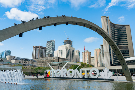 Toronto, SEP 29: Fountain at Nathan Phillips Square and Toronto Sign, city hall on SEP 29, 2018 at Toronto, Canada Editöryel