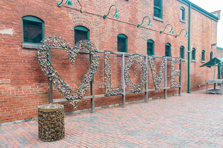 Toronto, OCT 5: Love lock wall in The Distillery Historic District on OCT 5, 2018 at Tornoto, Canada
