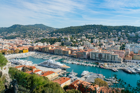 Nice, OCT 20: Aerial morning view of the famous Le Port with ships, building from Castle Hill on OCT 20, 2018 at Nice, France Standard-Bild - 118528729
