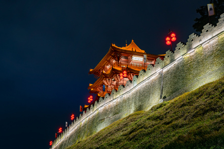 Night view of the Zhaoqing Ancient City Wall with Pi Yun Lou building at China Editorial