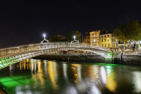 Night view of the famous Hapenny Bridge at Dublin, Ireland