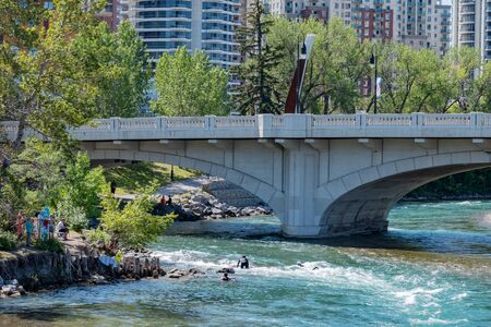 Calgary, AUG 3:  People playing under  the famous Louise Bridge on AUG 3, 2019 at Calgary, Canada