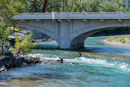 Calgary, AUG 3:  People playing under  the famous Louise Bridge on AUG 3, 2019 at Calgary, Canada 写真素材 - 129534508