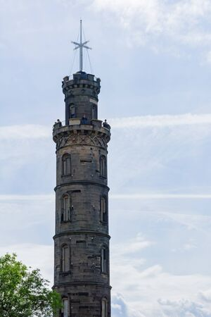Morning sunny view of the Nelson Monument at Edinburgh, United Kingdom 스톡 콘텐츠