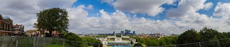 Morning high angle view of the Old Royal Naval College and cityscape from Green wich, London, United Kingdom