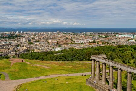 High angle view of the National Monument of Scotland with downtown cityscape at Edinburgh, United Kingdom