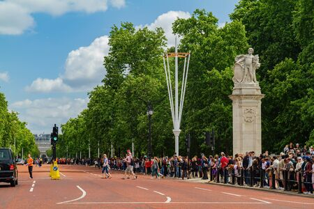 London, JUL 8: People watching the famous Guard Mounting of Buckingham Palace on JUL 8, 2011 at London, United Kingdom Editöryel