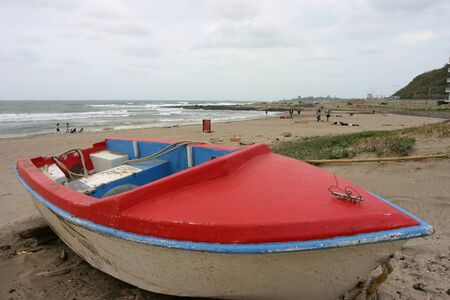 Red small boat on the beach at Keeling, Taiwan Stock Photo