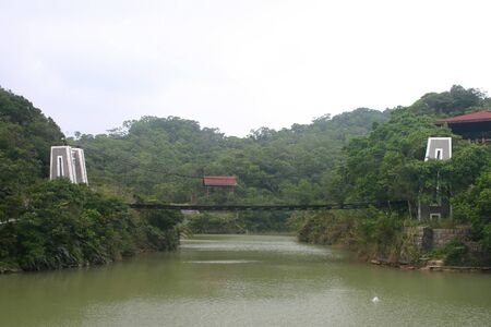 Overcast view of the Lovers Lake Suspension Bridge at Keelung, Taiwan