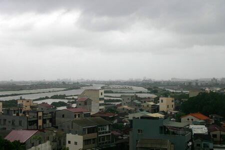 High angle cloudy view of the Anping District cityscape at Tainan, Taiwan