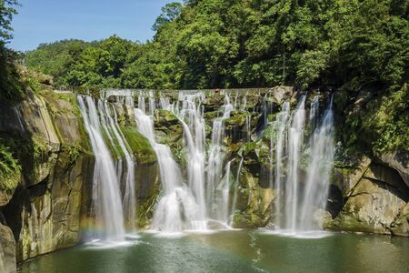 Morning view of the famous Shifen Waterfall with rainbow at New Taipei City, Taiwan Stock Photo